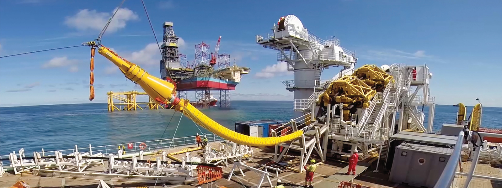 Cable laying vessel NKT Victoria installing an offshore cable with platform Martin Linge in the background