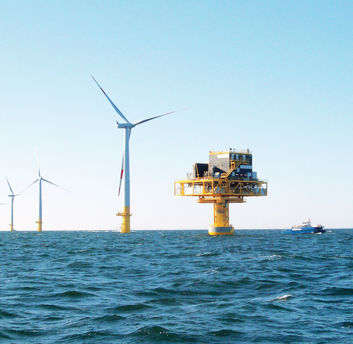 Triton Knoll offshore wind park with turbines and substation during sunny weather